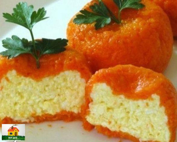 ОСТРАЯ СЫРНАЯ ЗАКУСКА «МАНДАРИНКИ» Ингредиенты:твердый сыр - 150 гр.плавленый сыр - 100 гр.яйца вареные - 2 шт.морковь средняя - 2 шт.чеснок - 4-5 зубчиковсольмайонезКак готовить:Сыр и яйца